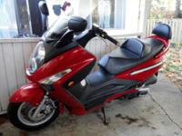 Selling a Red SYM 250RV Scooter 2009 In great