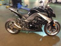 For sale is a 2010 Kawasaki z1000 black and silver