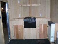 Custom built 15 foot V front ice fishing house, hunting
