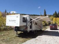 Stock Number: 714852. Great travel trailer for two to