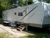 Totally livable travel trailer Front n rear bdrms