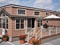 Stock Number: 725574. 11x36 Northwoods Lodge with loft,