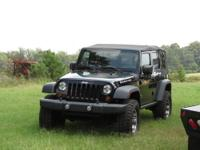 2010 Jeep Rubicon 4X4 Unlimited 4 door soft top. This