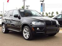 This 2010 BMW X5 4dr AWD 4dr 48i SUV features a 4.8L V8