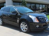 Clean CARFAX. This SRX Premium AWD comes loaded with a