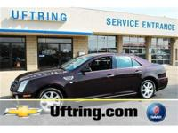 2010 Cadillac STS. Black Cherry Metallic Paint and
