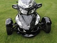 It has stereo, cruise, traction control, heated grips,
