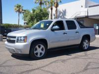 Check out this 2010 Chevrolet Avalanche LS. Go Green