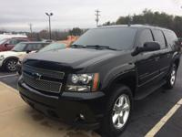 4WD and Ebony w/Custom Leather-Appointed Seat Trim. All
