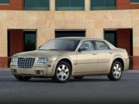 WOW!!! Check out this. 2010 Chrysler 300C Hemi Cream