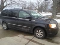2010 town and country touring. 7 passenger Stow and go