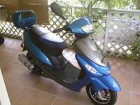 For sale is a 2010 scooter by Daixi. It has a 49 cc