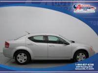 This is a 2010 Dodge Avenger SXT that is Silver on Gray