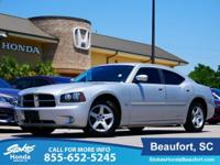 2010 Dodge Charger in Silver. Well loved! Raising the
