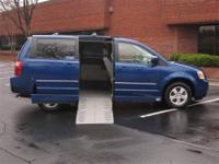 This is a 2010 Dodge Grand Caravan SXT with a 10 inch