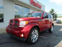 2010 DODGE NITRO HEAT 4X4 IN INFERNO RED. COMPLETELY