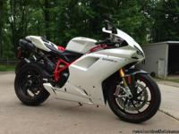 2010 Ducati 1198S, Pearl White with only 1,050 miles.