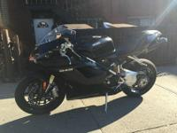 A beautiful 2010 Ducati Superbike 848.Low miles, never