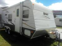 Rear corner bed. This trailer has an awning, spare