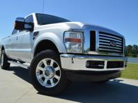 2010 Ford F-250 Crew Cab Lariat FX4. It is powered with
