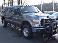 Loaded up F-250 Crew Cab with a Fisher stainless Plow,