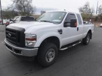 XL trim. Fourth Passenger Door, 4x4, Tow Hitch,
