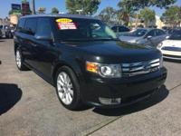 This BLACK METALLIC FORD FLEX IS A ONE OWNER CLEAN