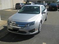 This is a 2010 Ford Fusion SE. Its exterior color is