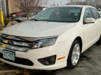 This white Ford Fusion is in very good condition. This