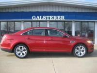 REDUCED! 1 OWNER! THIS TAURUS SEL IN RED CANDY METALLIC