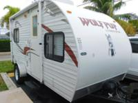 This 2010 Forest River Wolf Pup 16 travel trailer makes