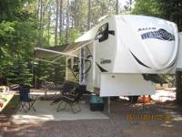 Spacious Rear Kitchen 5th wheel with enclosed