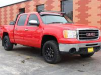 From home to the job site, this Red 2010 GMC Sierra