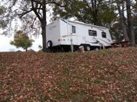 Like new travel trailer with slide, walk around bed,