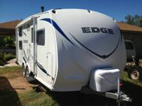 Aerodynamic, European styled travel trailer.  Less than