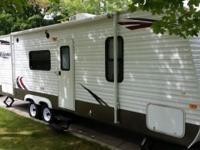 27' camper, sleeps 8 (bunks in rear). All the comforts