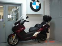 2010 Honda Siverwing,650cc maroon metalic. This scooter