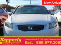 This 2010 Honda Accord EX-L in White Diamond Pearl