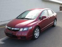 You are looking at a Burgundy, 2010 Honda Civic. This