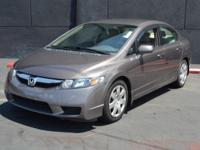 This 2010 Honda Civic Sedan 4dr LX Sedan 5-Speed AT