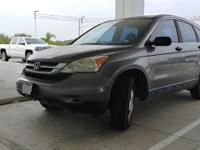 This 2010 Honda CR-V LX is proudly offered by Powell