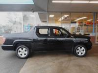 Fully loaded Honda Ridgeline 4x4 don't miss this one it