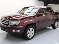 This awesome 2010 Honda Ridgeline 4x4 comes loaded with