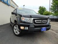 This Honda Ridgeline RTL is a great pre-owned car.