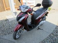 Honda Spree 50cc scooter, looks good, runs excellent, black