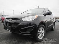 The 2010 Hyundai Tucson is a five-passenger compact