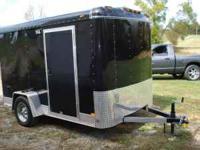 very nice 6x10 trailer, with rear drop ramp, side door