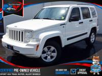 TAKE A LOOK AT THIS 2010 STONE WHITE JEEP LIBERTY SPORT