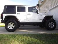 2010 JEEP RUBICON UNLIMITED FOR SALE. IT HAS A