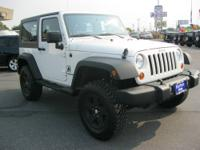 This well maintained 2010 Jeep Wrangler in White has